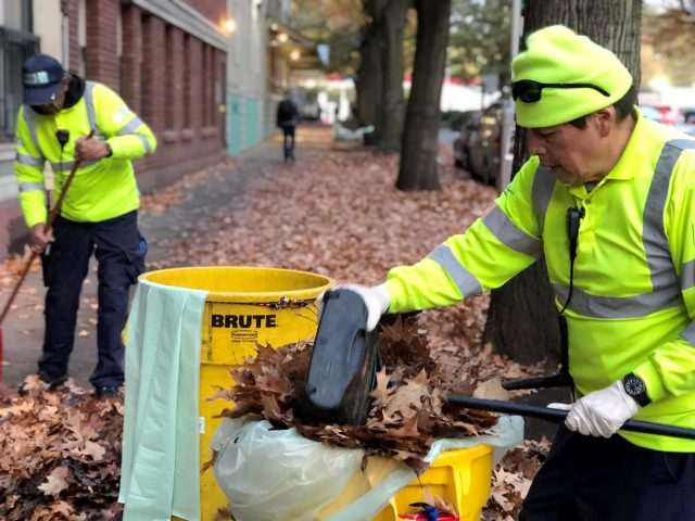 Downtown ambassadors clean up leaves in downtown Seattle
