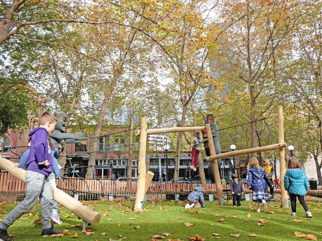Kids playing in the playspace at Occidental Square