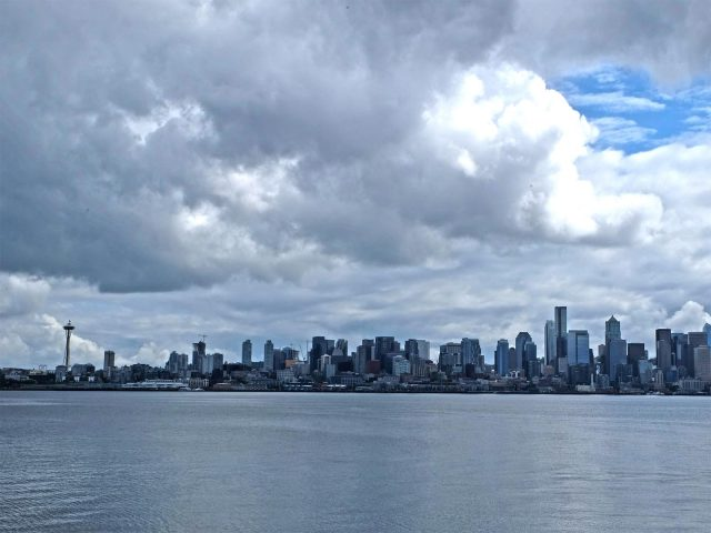 Seattle skyline, cloudy sky, water