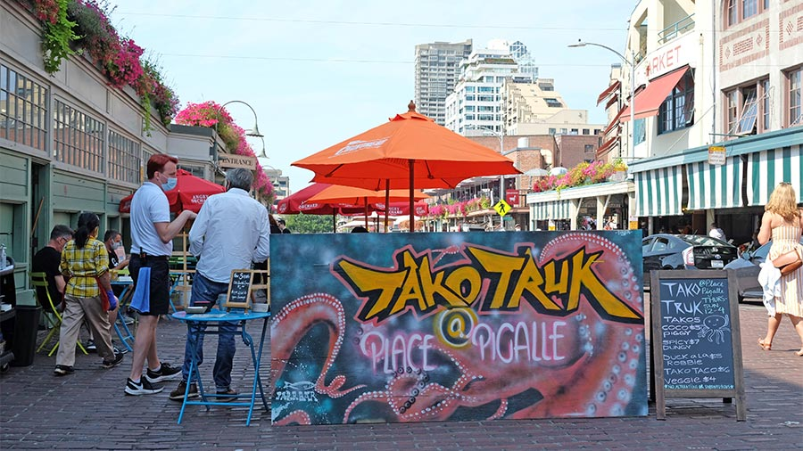 Visitors at a restaurant in a parking lane in Pike Place Market