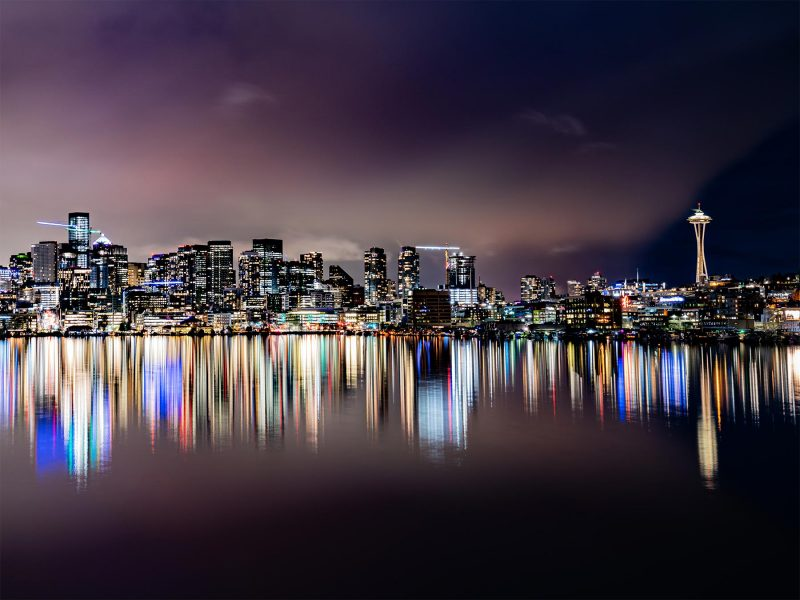 Seattle city lights at night reflected on water